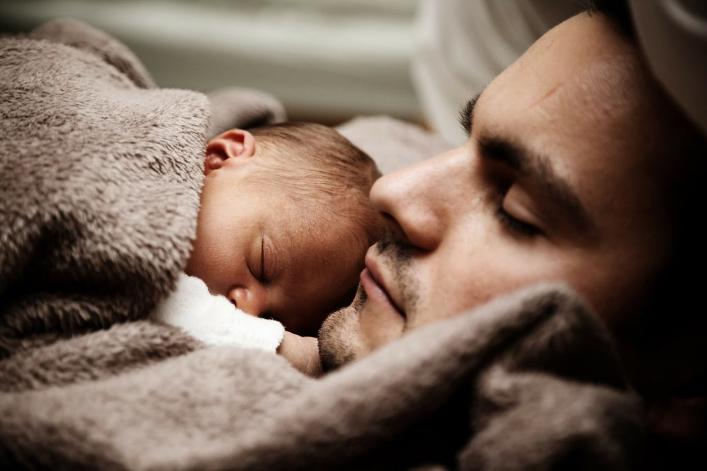 father holding newborn child